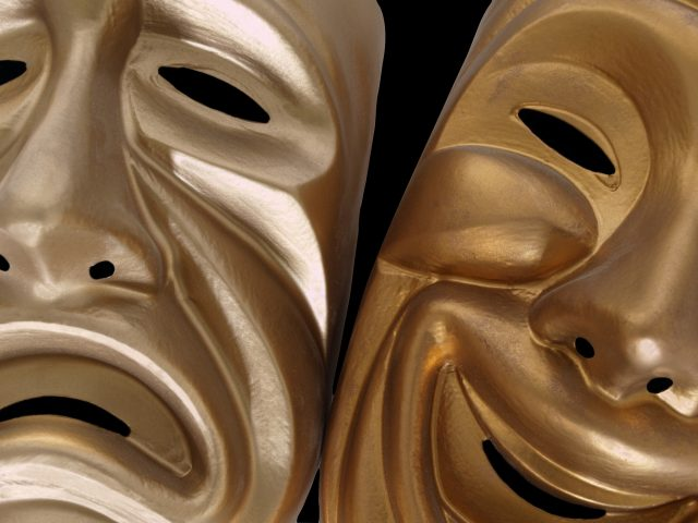 Theatrical comedy and tragedy masks, isolated on black.