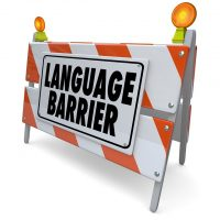 Language Barrier words on a blockade, banner or sign to illustrate difficulty in translating or interpreting meaning between people of different cultures sharing communication
