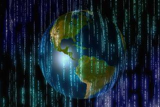 Globe encircled by computing code