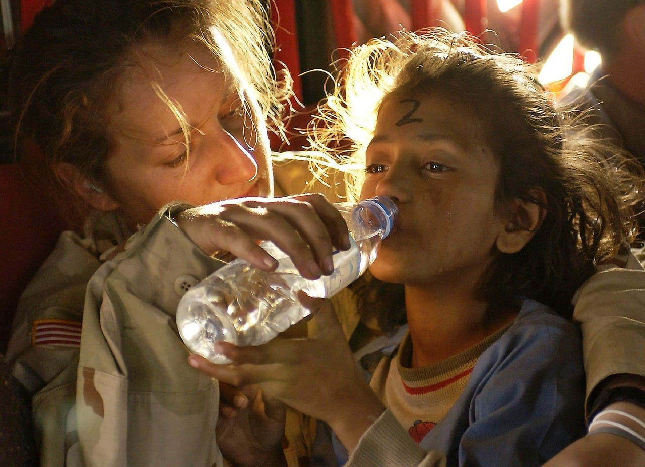 aid worker with child