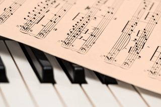 Music sheet and piano keys