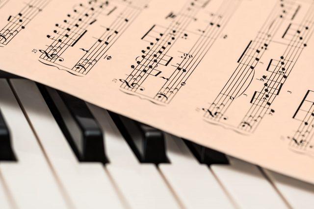Music sheet and piano keys